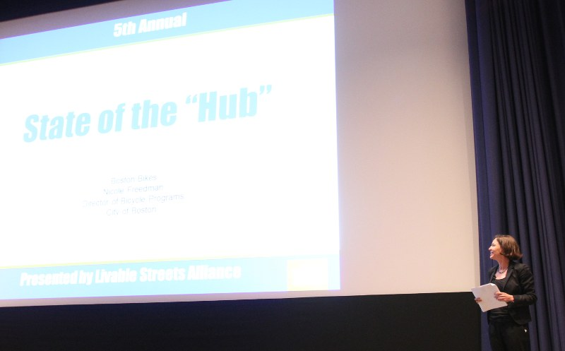 "Nicole Freedman next to a slide 'State of the ""Hub""'"