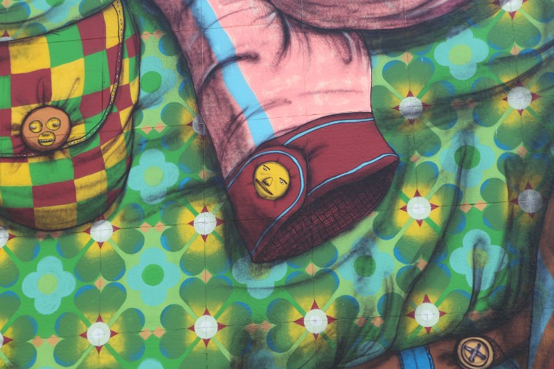 Detail of The Greenway Monster: jacket sleeve and button