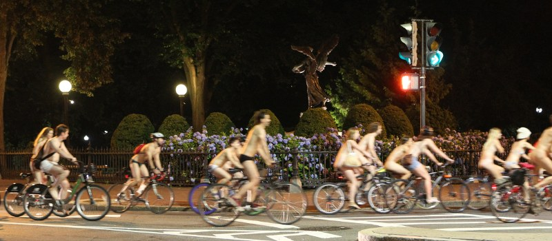 Semi-nude bicyclists ride near Boston's Public Garden