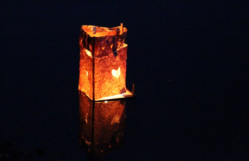 Homemade lantern on the water