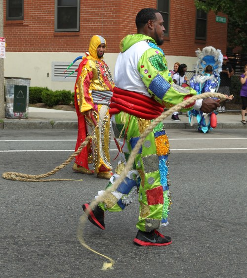 Costumed men with whips