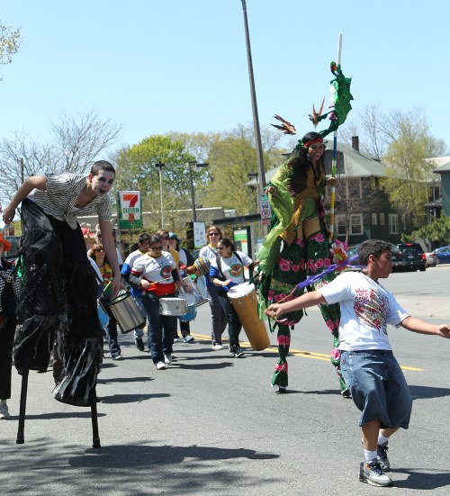 Wake Up the Earth parade: dancers on stilts