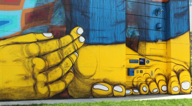 Detail of The Greenway Monster: yellow hands and feet