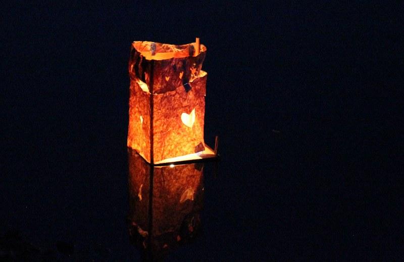 Homemade lantern on the water