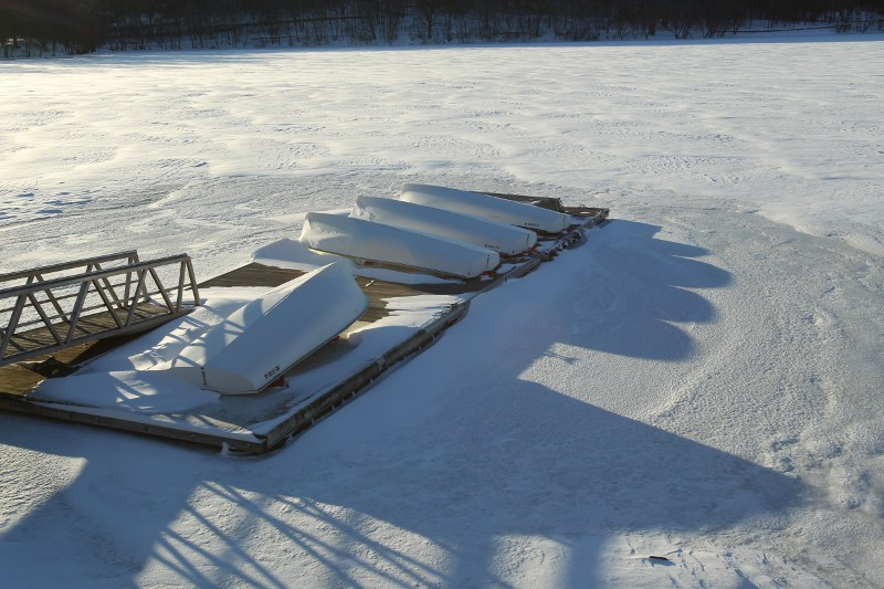 Boats on a frozen Jamaica Pond